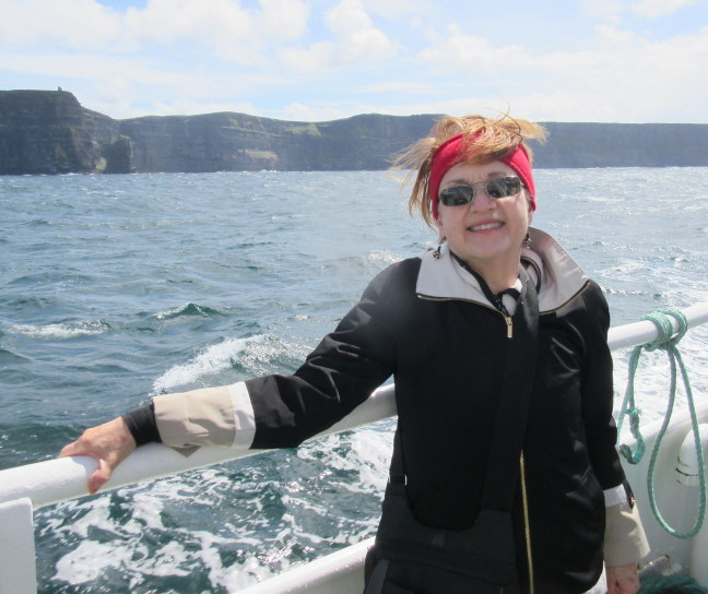 Susan on ferry to the Cliffs of Moher