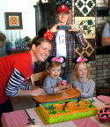 The whole family poses around the cake